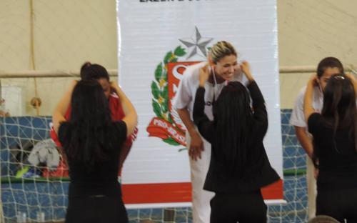 Preta, do Quilombo Pedro Cubas, recebendo a medalha de prata. Foto: Kauê Santos Silva/ADECC